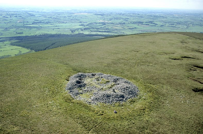Cairn (WI015-029002-) on Church Mountain, Co. Wicklow, Ireland  showing remains of church (WI015-029001-)  and holy well (WI015-029003-).   Td. Ballymooney | National Monuments Service
