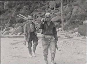 Tom McGuirk, and Tom Murphy on the way to the mine after sharpening pneumatic drills, early 1950s | Robert Carter