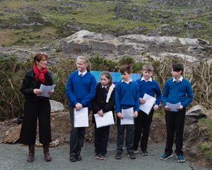 Principal Ann Savage and children from Scoil Chaoimhin Naofa reciting Charlie McCoy's poems. Some of the Children are descendants of mining families | Joe Haughton