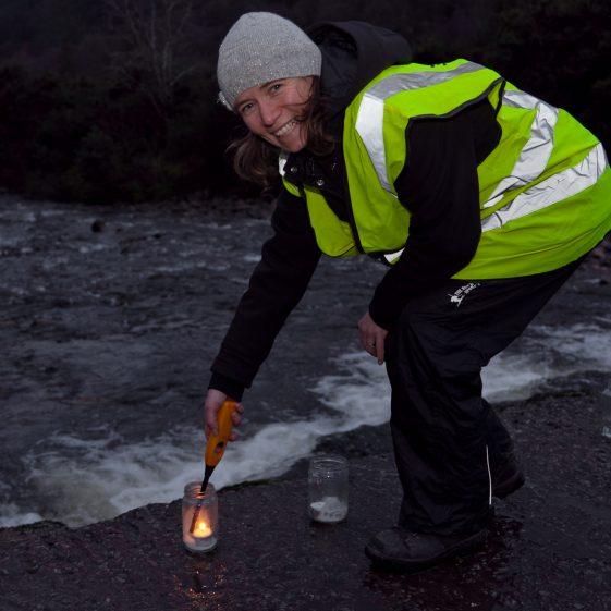 Deirdre Joynt of Glenmalure Pure Mile lighting the candles in Baravore car park at the start of '100 lights Walk' | Paul Messitt
