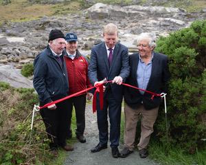Deputy Pat Casey TD, cutting the ribbon on the Miners' Way at Glendasan with former miners Sean O'Brien, Robert Carter and John Byrne   Joe Haughton