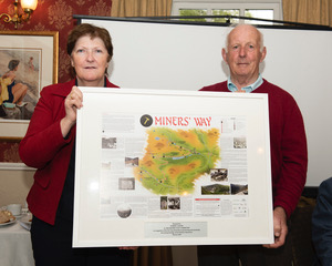 Joan Kavanagh presenting a framed copy of the Miners' Way Map to Robert Carter | Joe Haughton