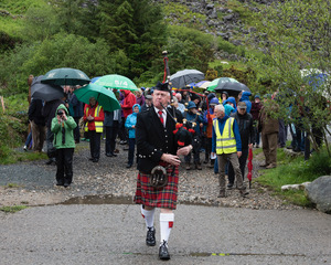 Local Piper James Byrne leading people on the first few metre of the Miners' Way | Joe Haughton