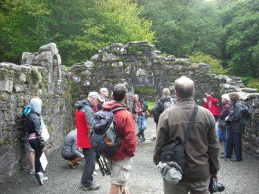 Visitors in Reefert Church, Upper Lake, Glendalough   Joan Kavanagh