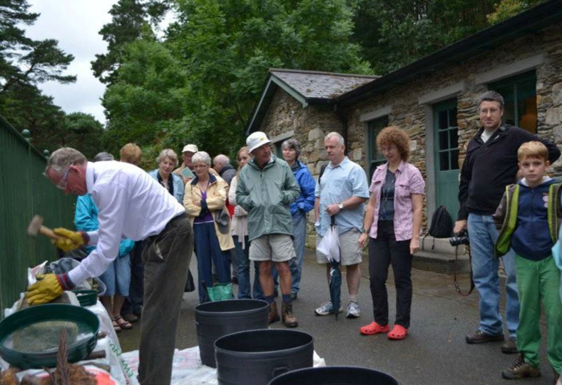Heritage Week event at Education Centre, Glendalough, 2012. Committee member Finian McEvoy demonstrating  'dressing' a piece of granite | Joan Kavanagh