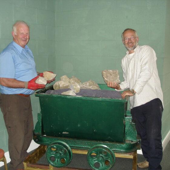 Robbie Carter and Zef Klinkerbergh examing the granite samples in the miner's bogey | Joan Kavanagh