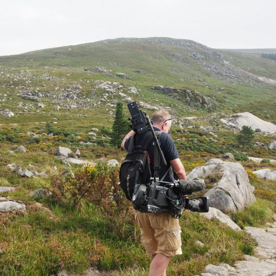 Colm the camera man carrying his equipment on the Miner's Way Trail | Joan Kavanagh