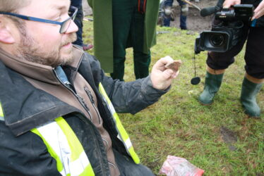 David Mc Ilreavy with artefact, being recorded by volunteer cameraman Lesley Burbridge. | Image by Frank Coyne