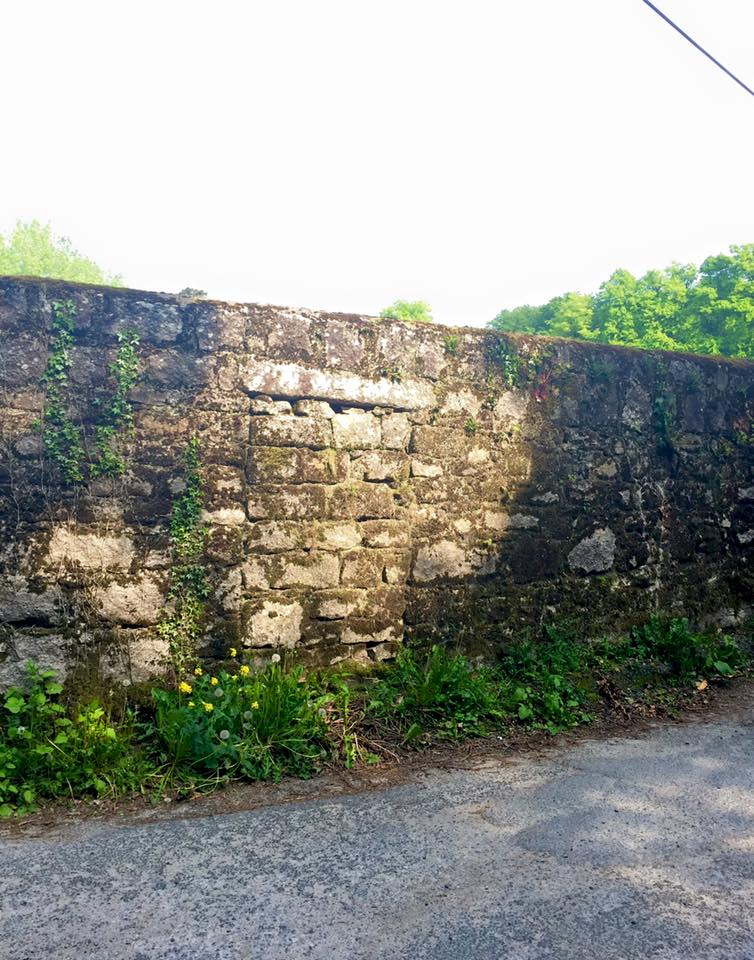 Blocked up doorway to Munny House Orchard at the bend of the wall at Captain's Cross. | Photo: Colum O'Rourke
