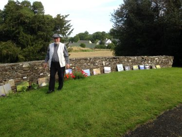 C.J. Darby Views The Photographs At St. Kevin's Church Grounds   Celine O Neill
