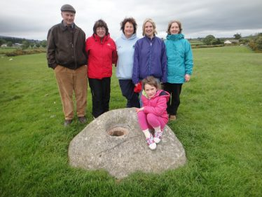 Volunteers and Bullaun stone | Roundwood Tidy Towns