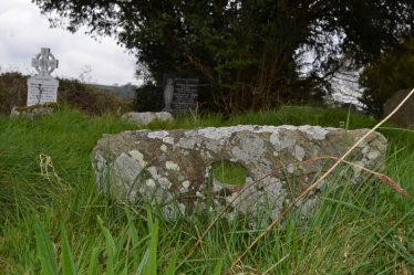 A Mill stone used as a gravemarker | D. Burns