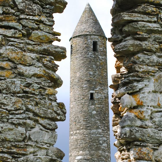 Glendalough's Round Tower Framed By the Church's Window Stonework   Michael Hughes