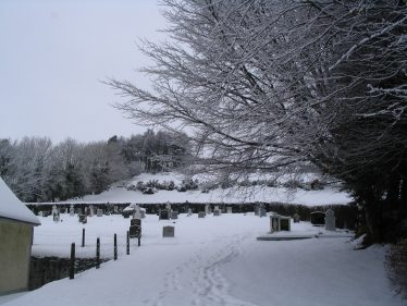 Church graveyard in the snow | The Askanagap Community Development Association