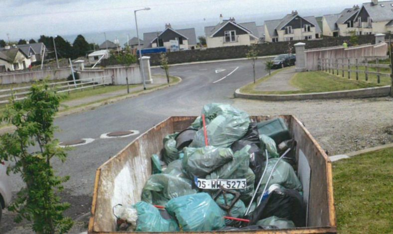 Fully filled skip after clean up | Ballyguile More Group