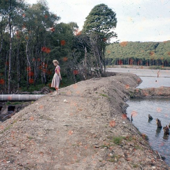 A woman overlooks part of the mining site