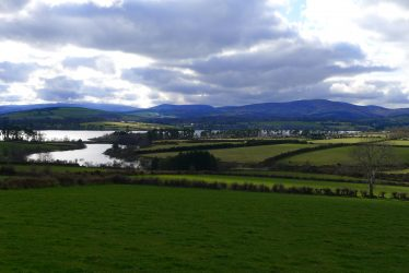 Late evening view of reservoir and fields | Roundwood Tidy Towns