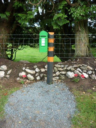 Newly painted feature postbox with stone wall and new planting | The Askanagap Community Development Association