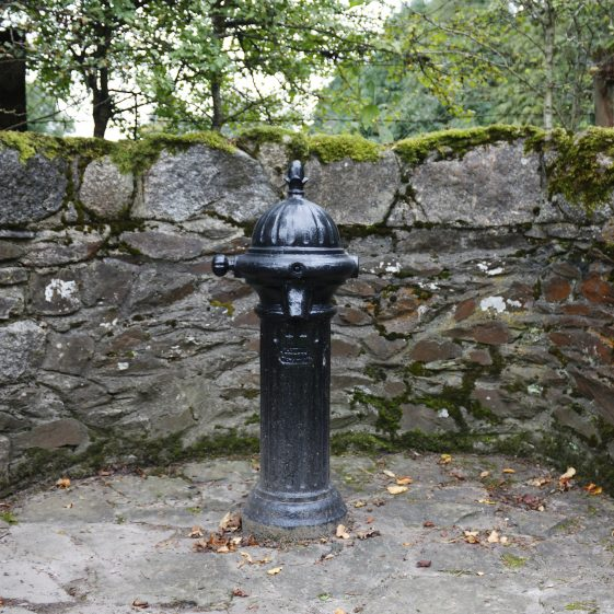 Pump in Dunlavin surrounded by stone wall | Dunlavin Tidy Towns