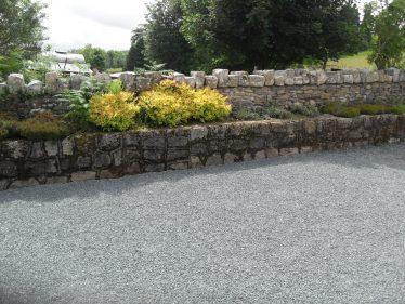 Repaired stone wall in sunshine | The Askanagap Community Development Association