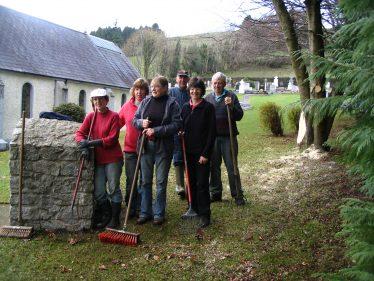 Volunteers at graveyard and church | The Askanagap Community Development Association