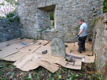 David working out logistics of mulch/cardboard laying inside the Medieval Church at Old Conna/Connaught | The Medieval Bray Project