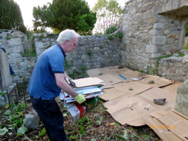 Maurice laying mulch aka cardboard to keep the weeds suppressed in an eco friendly manner, pending further work.  | The Medieval Bray Project