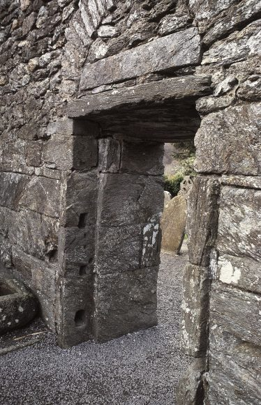 7. The west doorway from within, showing two slots for beams to secure the door from the inside (J. Scarry).   Courtesy of Con Manning & Wordwell Publishing