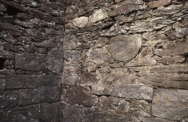8. Two D-shaped stones built into the north-west corner of the nave (J. Scarry). | Courtesy of Con Manning & Wordwell Publishing