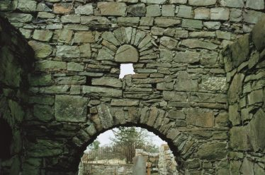 9. An external view of the original east window of Confey church with D-shaped stone tympanum in place. The lower part of this window was removed when a chancel arch was inserted in the wall (C. Manning). | Courtesy of Con Manning & Wordwell Publishing