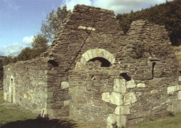 Trinity Church; note the corbels at the corners | Courtesy of Con Manning, Archaeology Ireland and Wordwell Publishing