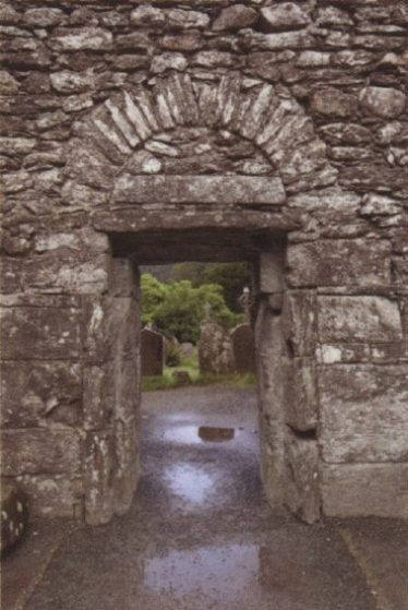 Interior view of the west doorway of the Cathedral. Note the arch and tympanum, here filled with masonry | Courtesy of Con Manning, Archaeology Ireland and Wordwell Publishing