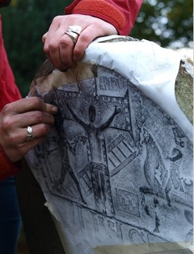 Recording a gravemarker | Courtesy of Our Wicklow Heritage